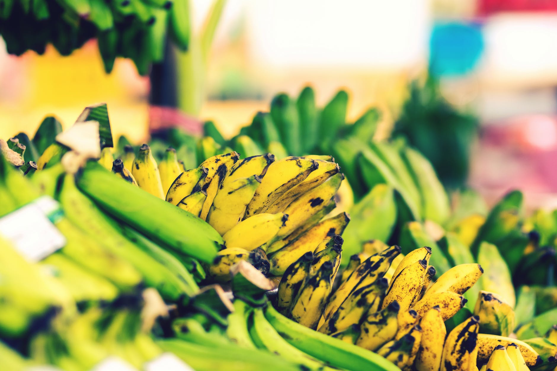 Picture of bananas on a market stall.