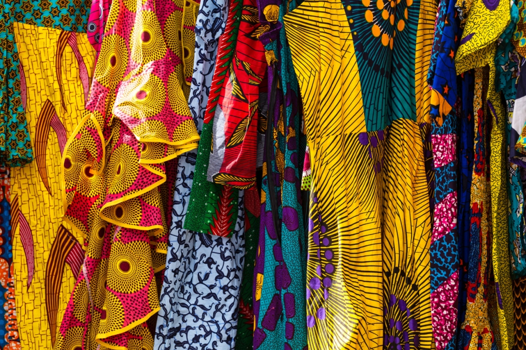 West African clothes hanging up to sell.